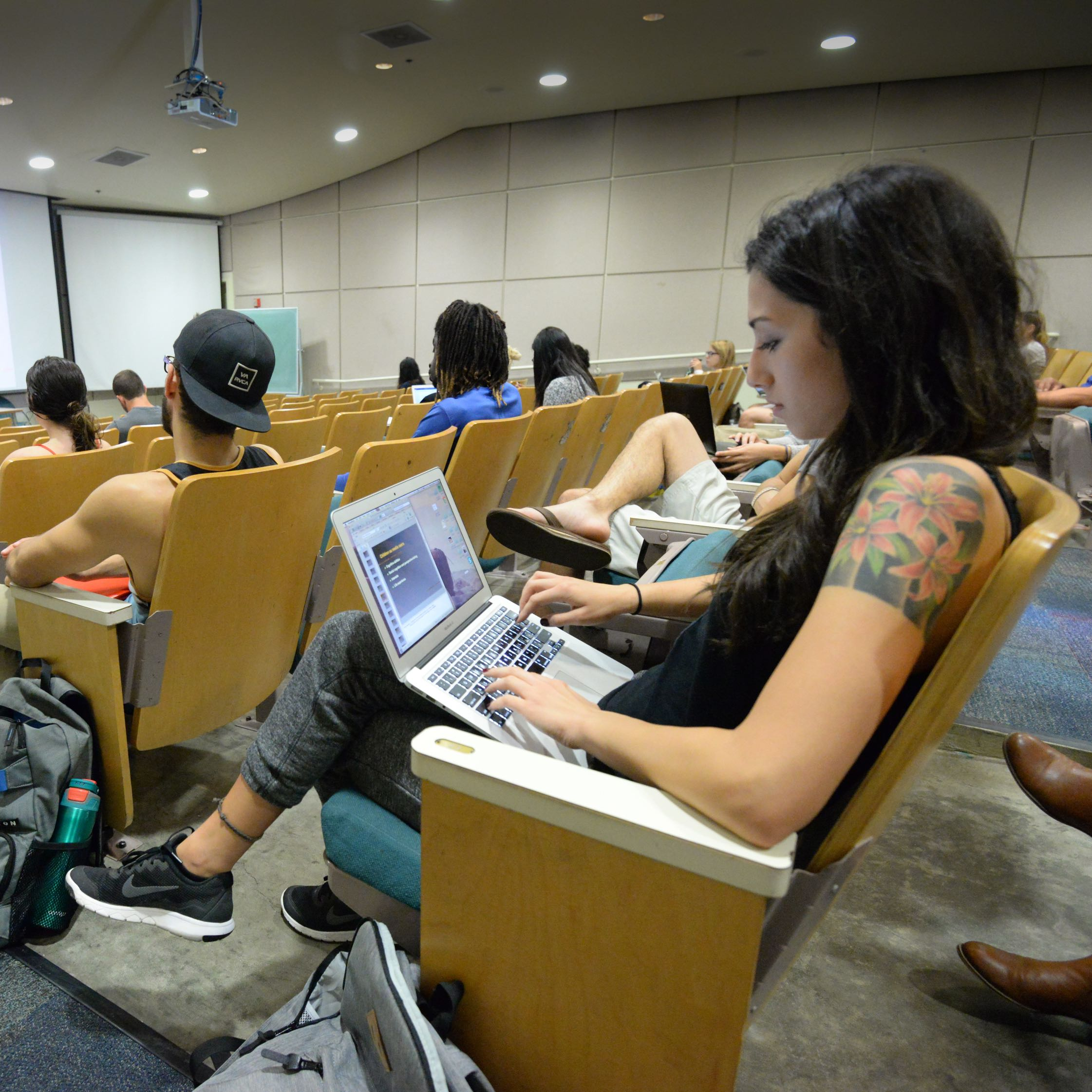 Student studying in lecture hall