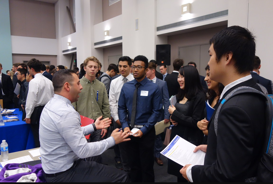 employer and students speaking at an event