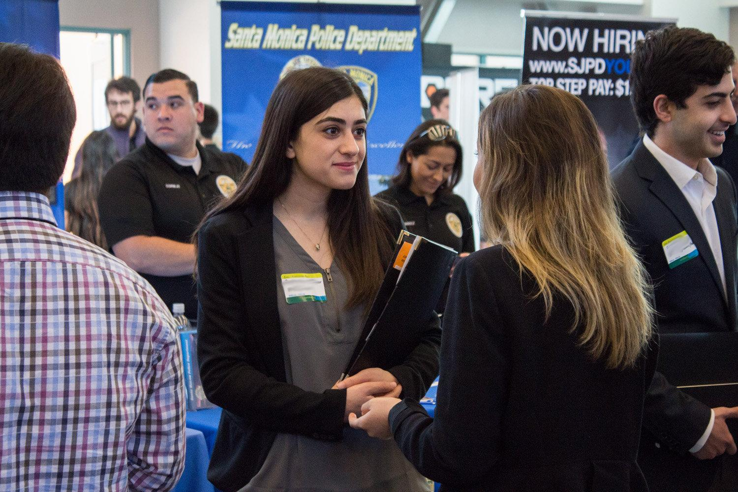 photo of students and recruiters speaking for career fairs